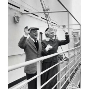 senior-couple-standing-on-the-deck-of-a-cruise-ship-and-waving-poster-print-18-x-24_1640167